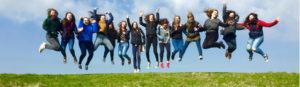 Ursuline College Girls jumping in air