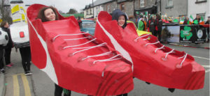 Ursuline College Girls in crafted red trainer boots for St Patricks Day